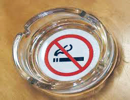 Ash tray with no smoking sign in it